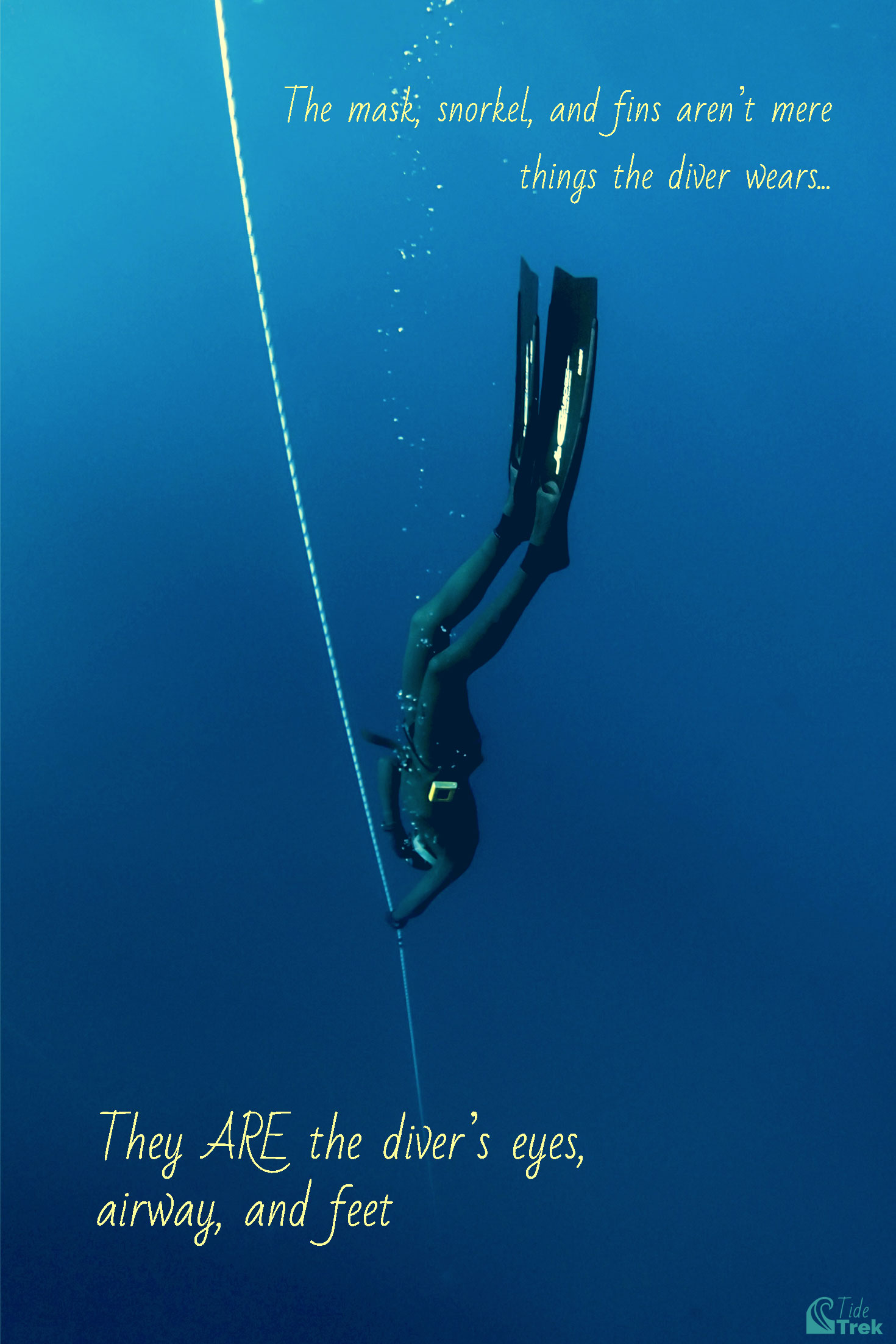 Freediving man descending vertically along a line wearing a freediving wetsuit and long freediving fins