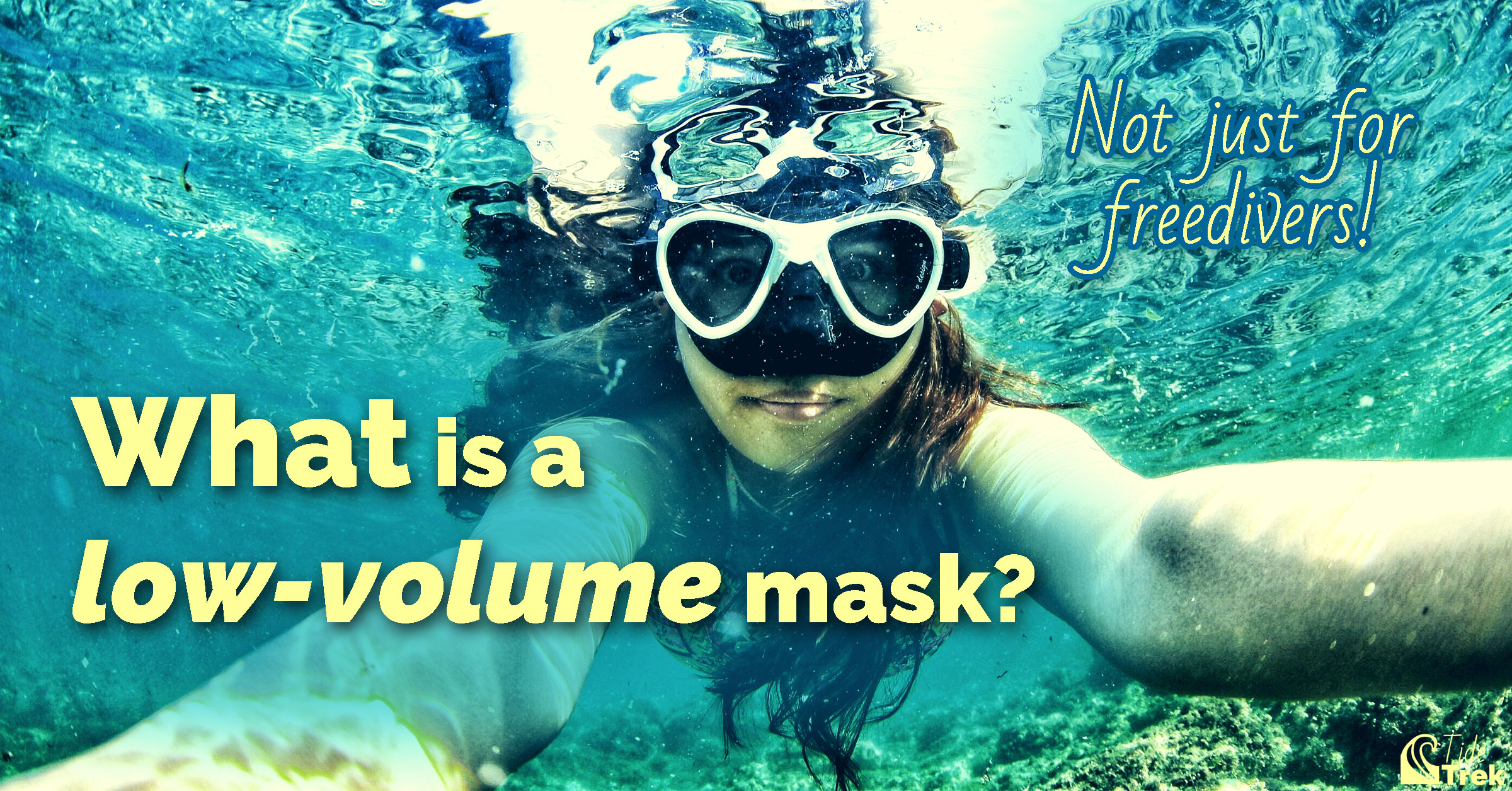 Underwater photo of a woman wearing a low-volume mask. What is a low-volume mask?